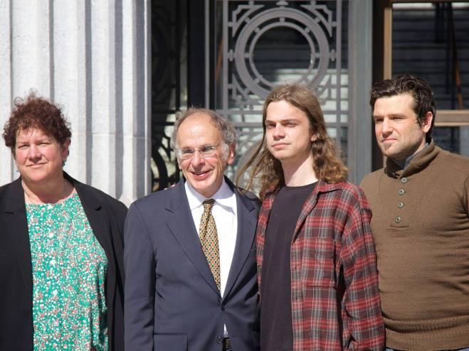 Scott Olsen and his legal team, Rachel Lederman, Jim Chanin, Olsen and Jacob Crawford